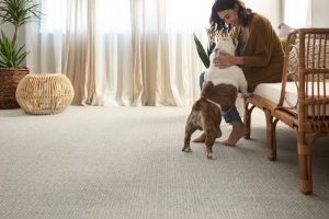 Woman with dog on Carpet | Flooring Concepts
