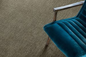 Blue chair on grey Carpet | Flooring Concepts