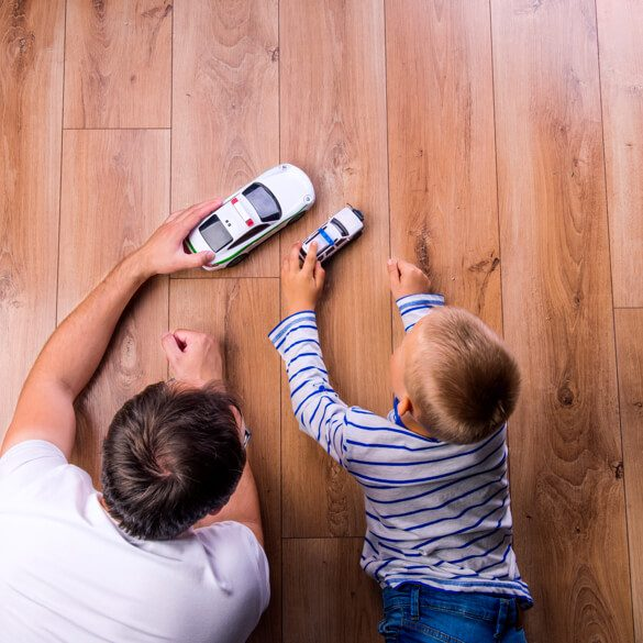 Kid and dog playing with toy car | Flooring Concepts