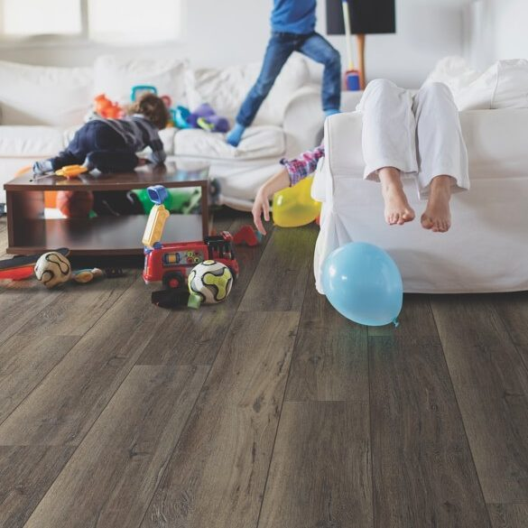 Kids playing on luxury vinyl tile flooring | Flooring Concepts